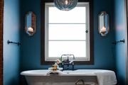 blue master bathroom with chandelier