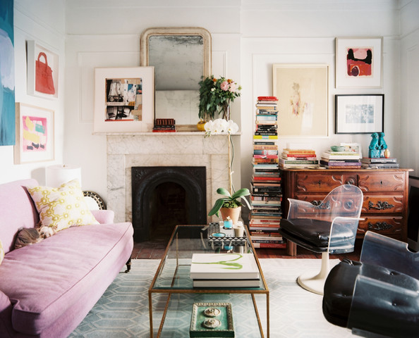 Mantel - A purple couch paired with a pair of vintage Lucite chairs