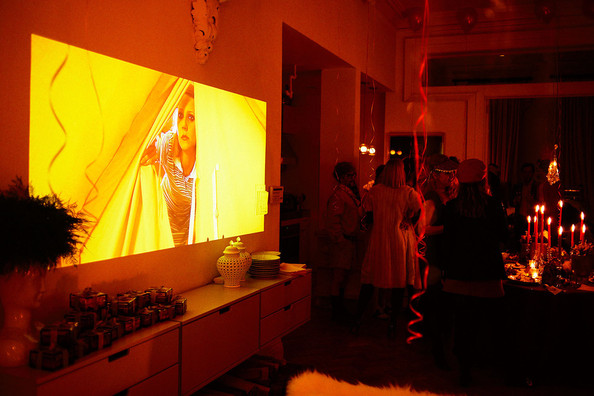 Media Room - A movie projector displays a loop of Wes Anderson films