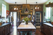 This eclectic kitchen has a green and brown color palette.