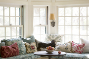A windowed banquette with round table and stools