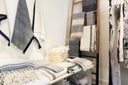 Linens and blankets hung on a ladder