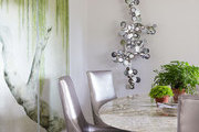 Metallic seating around a marble-topped dining table