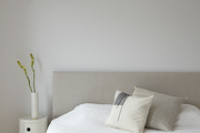 A minimal all white bedroom