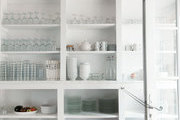 Open shelving exposes a collection of kitchenware