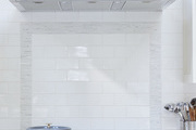 A contemporary kitchen with white tile.