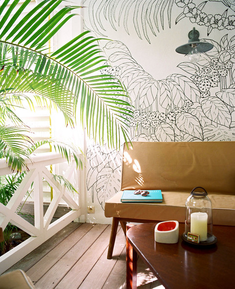 Patio - A wall mural in an outdoor sitting area at La Banane