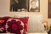 Artworks grouped above a bed