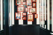 Black-and-white stripes with photos in red frames