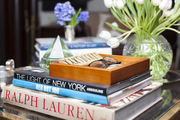 Detail of books and decor items on a table.
