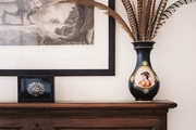 Mantel styling with art and feathers