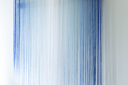 Ombre blue hanging wall art.