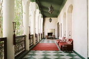 Open-air walkways accented with Moroccan architecture