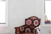 An embroidered chair in Aelfie's living room