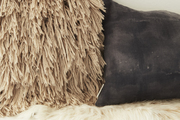 Pillows and a cowhide create a mix of textures on this bench.
