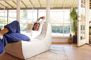 Actress Joy Bryant in her sunny living room