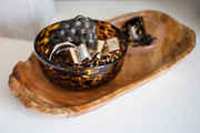 A tortoiseshell bowl with jewelry