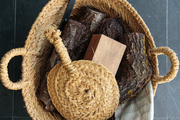 Fire-stoking essentials in a woven basket