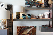 Designs by Antoinette Faragallah displayed on floating shelves at Gray Gallery in West Hollywood