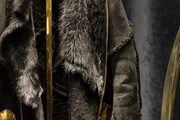 A detail of a leather jacket with fur accents.