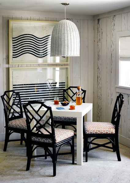 Specialty Room - A white Parsons table surrounded by painted rattan chairs