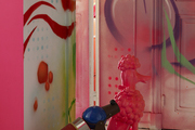 Spray paint, graffiti, a pink poodle, and a robot in a Paris apartment