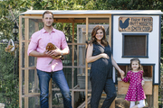 Tiffani Thiessen and family hang out by their backyard chicken coop