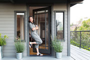 Actress Katie Lowes in the door of her Craftsman-style home