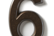 A traditional house number in a bronzed finish