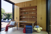 Modern workspace with bamboo cabinets and built-in fold out desk.