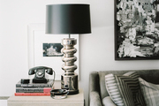 A gray velvet sofa paired with black-and-white art