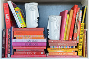 Fun bookends holding up a tonal range of books.