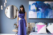 A portrait of Athena Calderone in her designed space