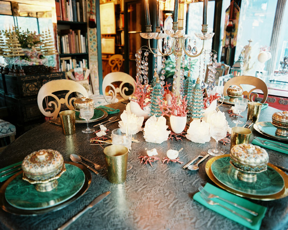 Tablescape - A dining table decorated with snakeskin and malachite patterns