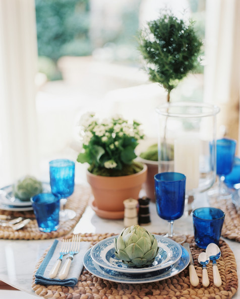 Tablescape - A table set with woven place mats, blue-and-white dishes, and potted plants