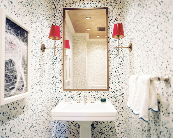 Tower Rack - Splatter wallpaper and red-lacquered lampshades in a powder room