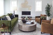A contemporary living space with a green sofa.