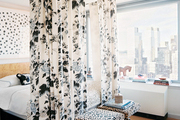 A floral bed canopy and a pair of leopard-print benches