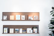 Wall shelving with magazines and books.