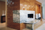 Woven-wood walls and a marble fireplace surround