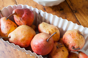Peaches and pears on a rustic wood table