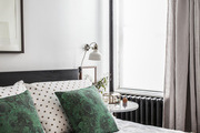 Mix and matched linens in a Brooklyn master bedroom