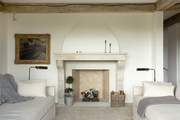 Fireplace and mantel in all white contemporary living room.