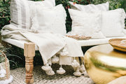 A neutral palette patio with a pop of gold.