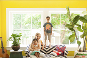 Meyer poses in the living room with her children: Clement, 6, and Georgia, 4