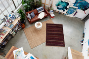 Overhead shot of seating and layered rugs.