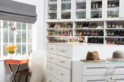 Tiffani Thiessen's well-organized closet boasts a modern light fixture