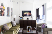 A living room adorned with modern portraits and photography