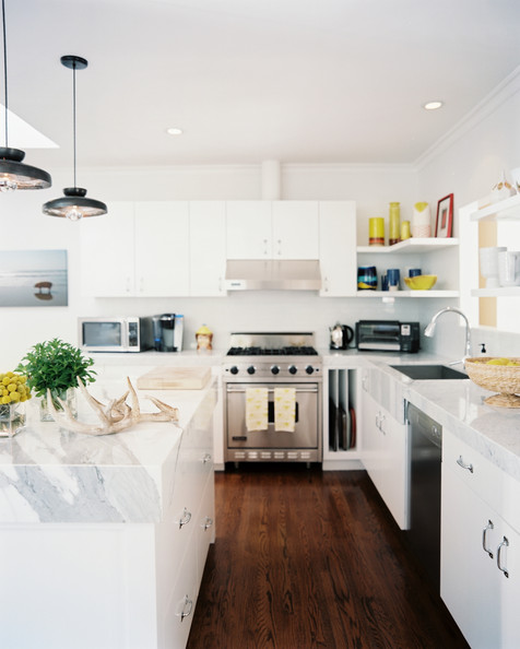 White Kitchen  Marble countertops and white cabinetry in a bright