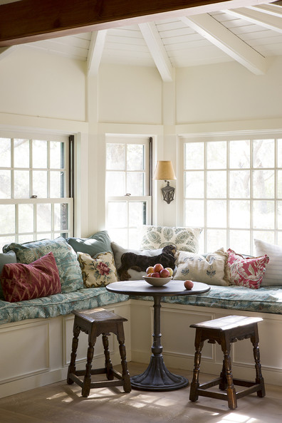 Window Seat - A windowed banquette with round table and stools